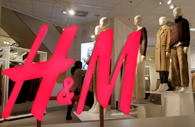 Logo of H&M is seen in a display window of a store in Zurich