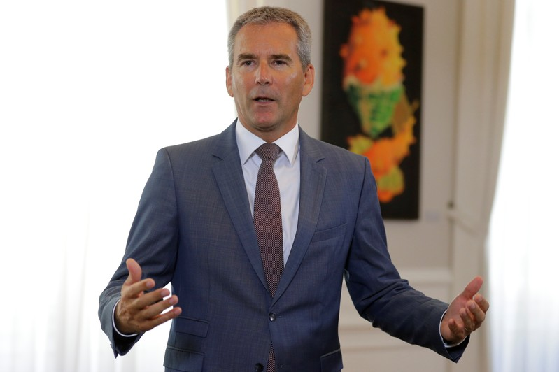 Austria's Finance Minister Loeger addresses the media before a cabinet meeting in Vienna