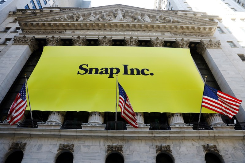 The front of the New York Stock Exchange (NYSE) with a Snap Inc. logo hung on the front of it stands shortly before the company's IPO in New York