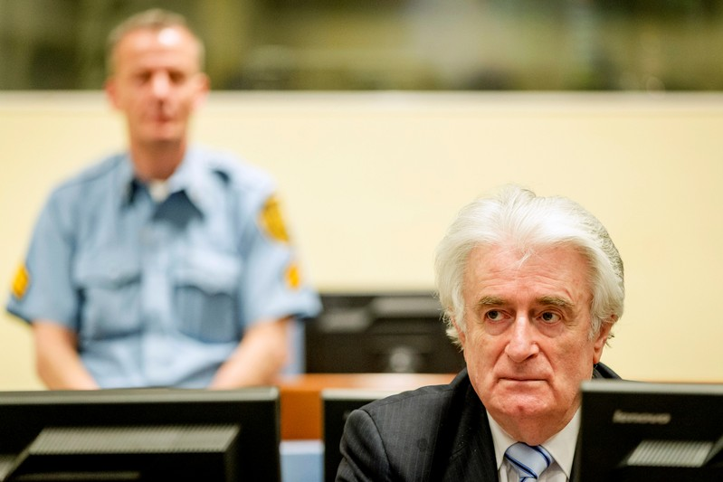 FILE PHOTO: Ex-Bosnian Serb leader Karadzic sits in the court of the International Criminal Tribunal for former Yugoslavia in The Hague