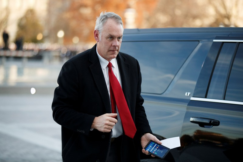 FILE PHOTO: U.S. Secretary of the Interior Ryan Zinke arrives at the U.S. Capitol prior to the service for former President George H. W. Bush in Washington, DC, USA