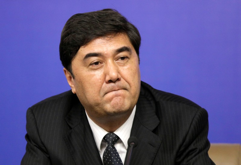 Nur Bekri, Chairman of Xinjiang Uygur Autonomous Region, attends a news conference in Beijing