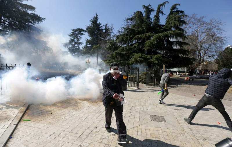 Supporters of the opposition party attend an anti-government protest in front of the Parliament in Tirana