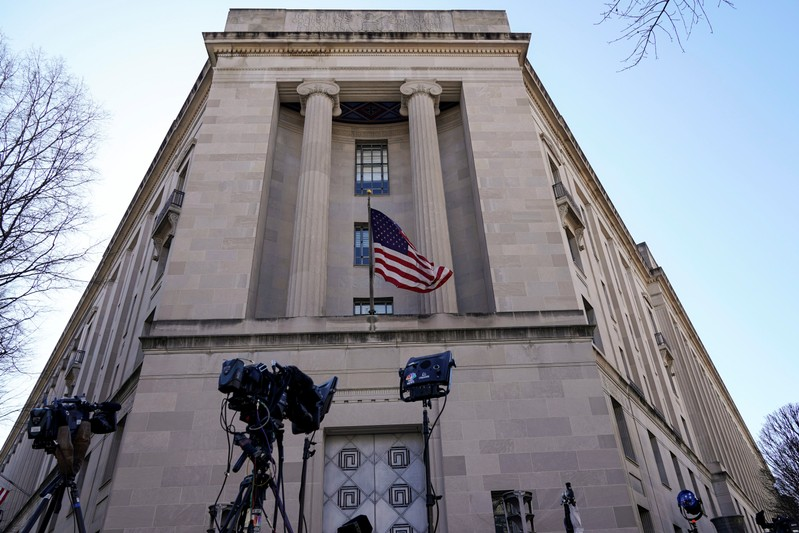 Television cameras stand in front of the Department of Justice the day after Special Counsel Robert Mueller delivered his report into Russia's role in the 2016 U.S. election and any potential wrongdoing by President Donald Trump in Washington