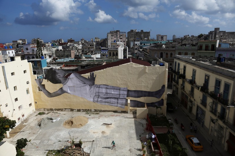 A giant photograph of a boy by French photographer and artist JR is seen on a wall, during the 13th Havana Biennial, in Havana