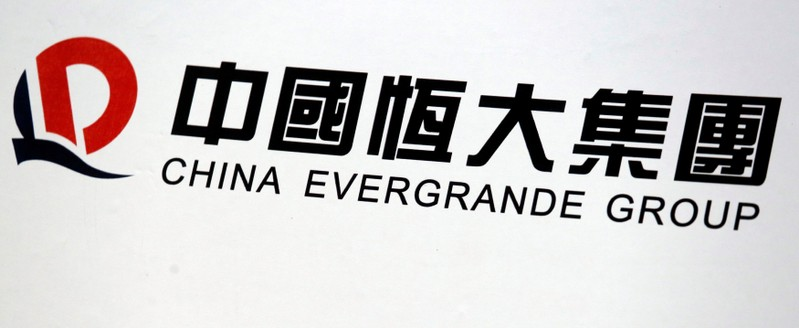 A logo of China Evergrande Group is displayed at a news conference on the property developer's annual results in Hong Kong