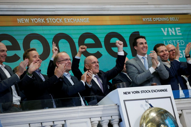 FILE PHOTO: Jan Carlson, CEO of Veoneer, Inc., rings the opening bell to celebrate it's first day of trading on the floor of the NYSE in New York