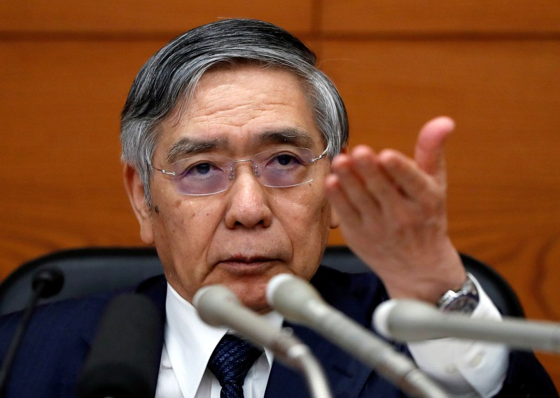 FILE PHOTO : Bank of Japan Governor Haruhiko Kuroda attends a news conference at the BOJ headquarters in Tokyo
