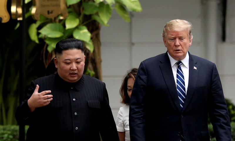 FILE PHOTO: North Korea's leader Kim Jong Un and U.S. President Donald Trump talk in the garden of the Metropole hotel during the second North Korea-U.S. summit in Hanoi