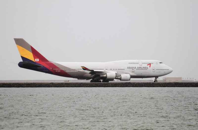 FILE PHOTO: An Asiana Airlines Boeing 747-400 taxis at San Francisco International Airport