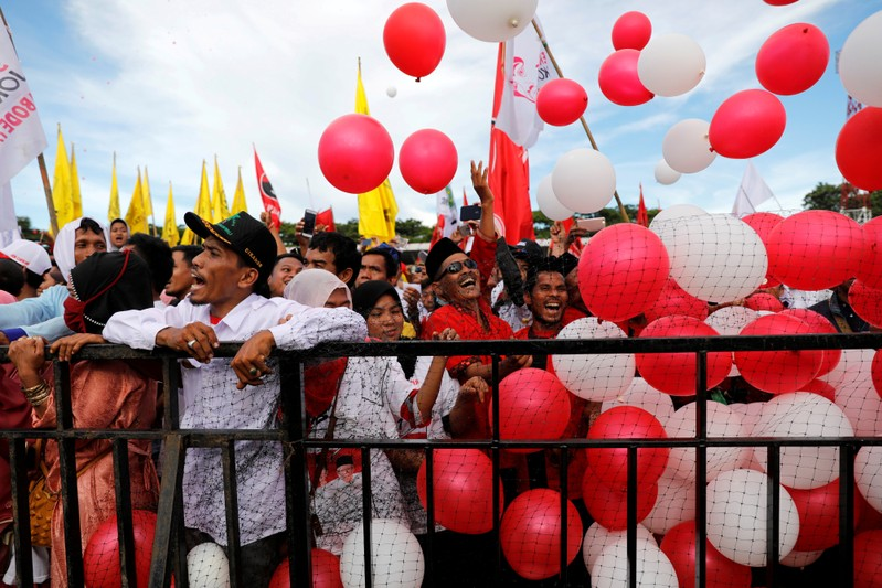 FILE PHOTO: Supporters throw balloons as they attend a campaign rally of Indonesia's presidential candidate for the next general election Joko Widodo at a stadium in Serang