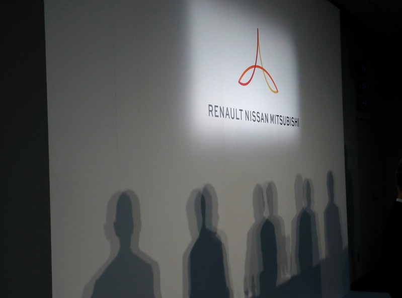 Renault CEO Thierry Bollore, Renault Chairman Jean-Dominique Senard, Nissan CEO Hiroto Saikawa, Mitsubishi Motors Chairman and CEO Osamu Masuko cast their shadows at a joint news conference in Yokohama