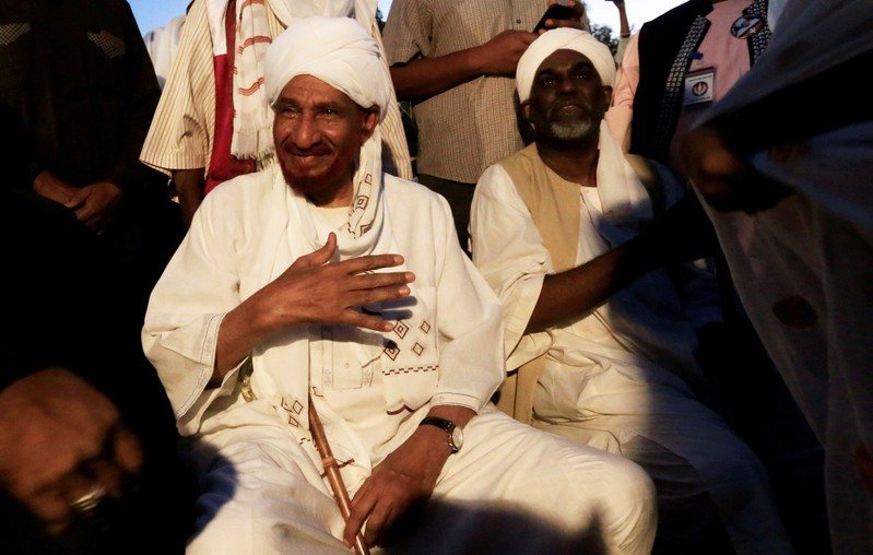 FILE PHOTO: Sudanese opposition figure Sadiq al-Mahdi meets his supporters after he returned from nearly a year in self-imposed exile in Khartoum