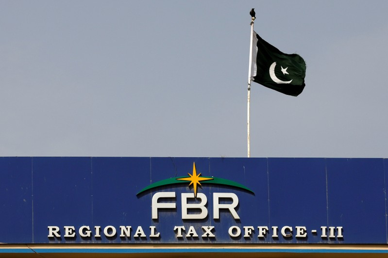 FILE PHOTO: The national flag is seen on the Federal Board of Revenue (FBR) office building in Karachi
