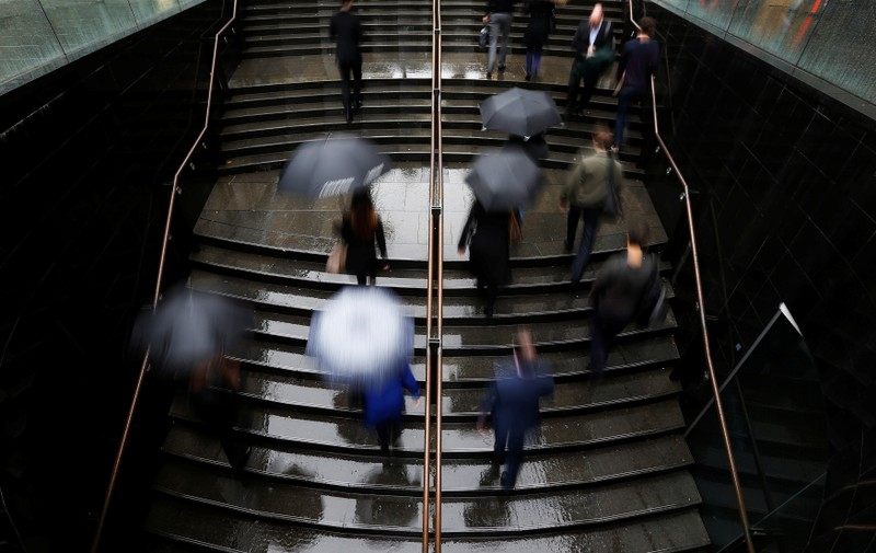 FILE PHOTO: Commuters arrive to the Central Business District at the morning rush hour in Sydney