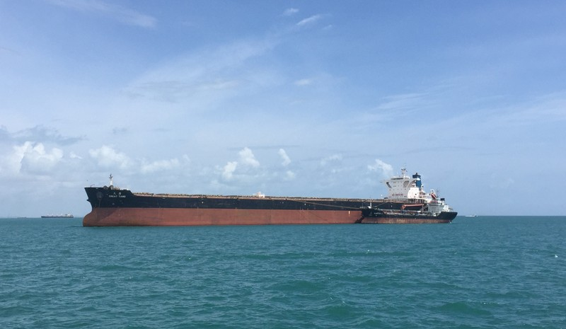 Capesize dry-bulk ship, the Great Tang, takes on bunker fuel in the Sing Straits