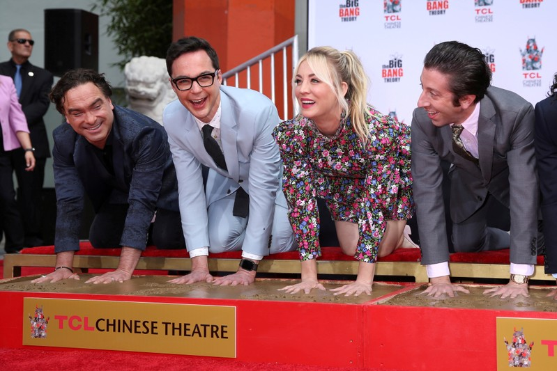 FILE PHOTO: Actors Johnny Galecki, Jim Parsons, Kaley Cuoco and Simon Helberg participate in the cement handprints ceremony for the cast of the television comedy