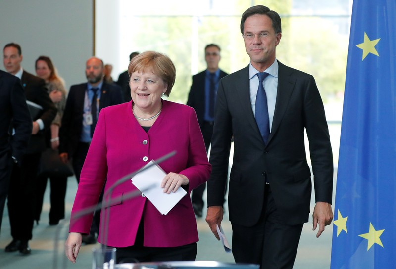 German Chancellor Merkel and Dutch PM Rutte arrive for a news conference at the Chancellery in Berlin