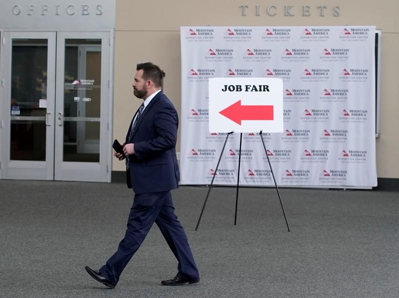 A man walks into register at a military job fair in Sandy, Utah