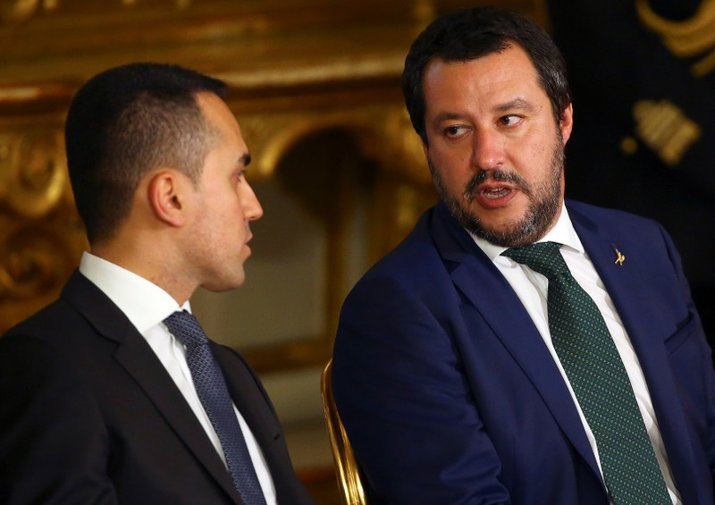 Interior Minister Matteo Salvini talks with Italy's Minister of Labor and Industry Luigi Di Maio at the Quirinal palace in Rome