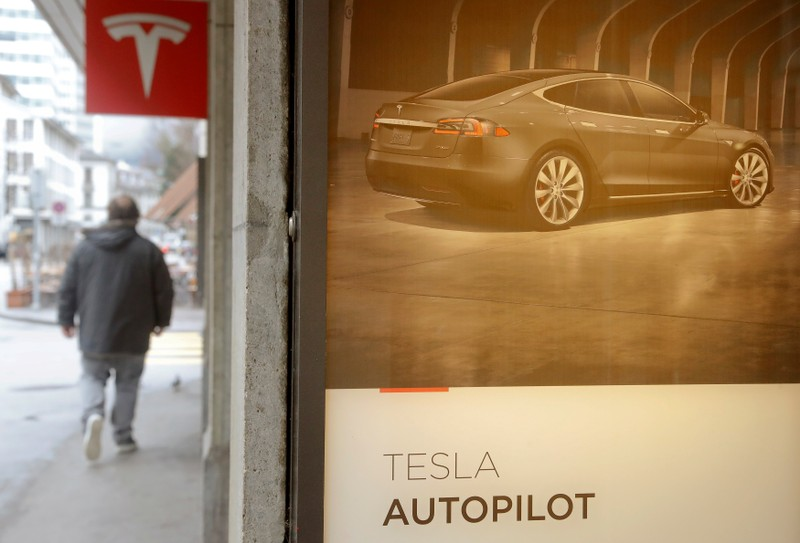 Advertisement promotes Tesla Autopilot at a showroom of U.S. car manufacturer Tesla in Zurich