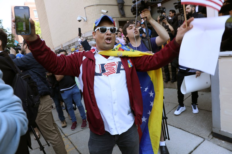 Guaido supporters celebrate outside the Venezuelan embassy during police raid in Washington