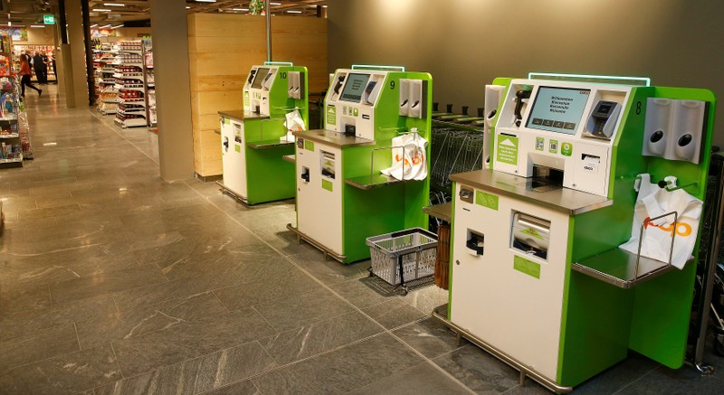FILE PHOTO: Self checkout machines are seen at a supermarket of Swiss retail group Coop in Zumikon
