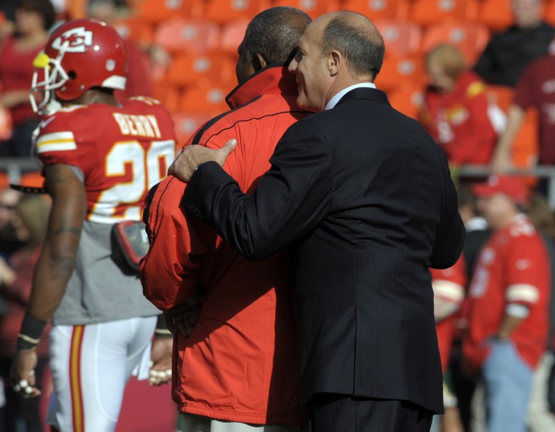 FILE PHOTO: Kansas City Chiefs head coach Romeo Crennel is hugged by general manager Scott Pioli before the start of their NFL game against the Carolina Panthers