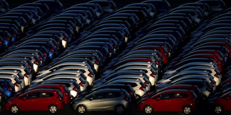 Newly manufactured cars await export at port in Yokohama