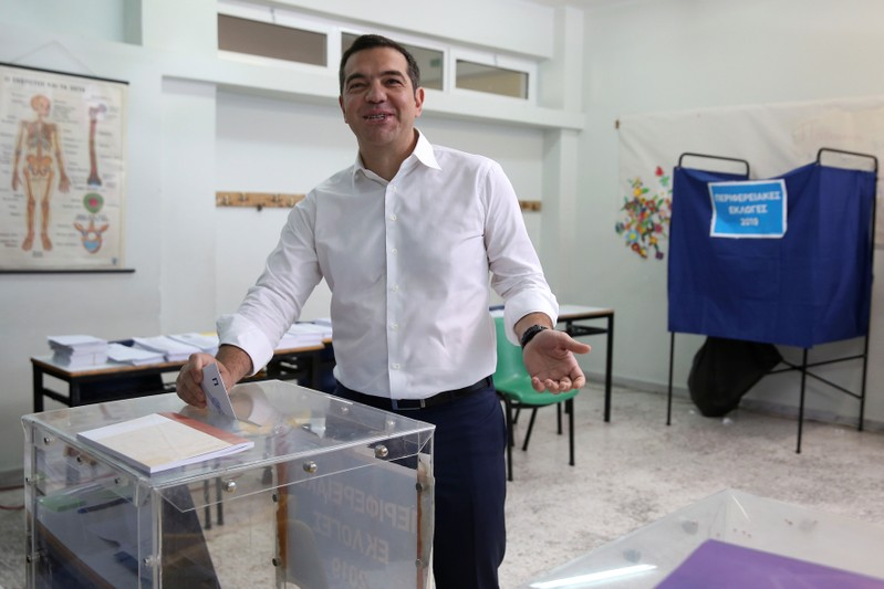 Greek PM Tsipras prepares to cast his vote for the European and local elections at a polling station in Athens
