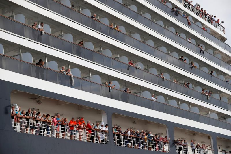 Cruise firm seeks new virus test for passenger from ship in Cambodia