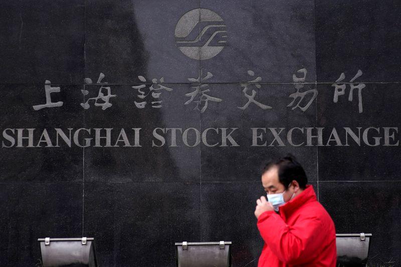 Asian stocks slip as virus' regional spread spooks investors