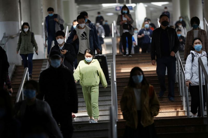 China tightens Russian border checks, approves experimental coronavirus vaccine trials