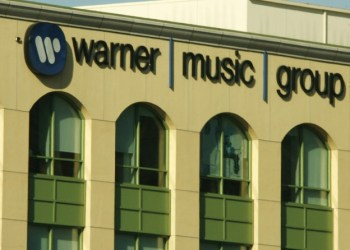 Warner Music strikes a chord as shares pop on Nasdaq debut