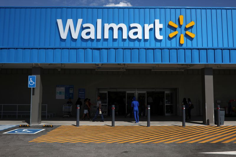 The logo of Walmart is seen outside of a new Walmart Store in San Salvador