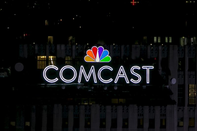 FILE PHOTO: The NBC and Comcast logo are displayed on top of 30 Rockefeller Plaza, formerly known as the GE building, in midtown Manhattan in New York