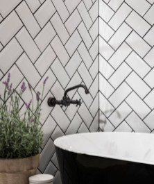 Elegant black herringbone tiles for your space 01