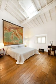 Vintage attic bedroom with wall of skylights13