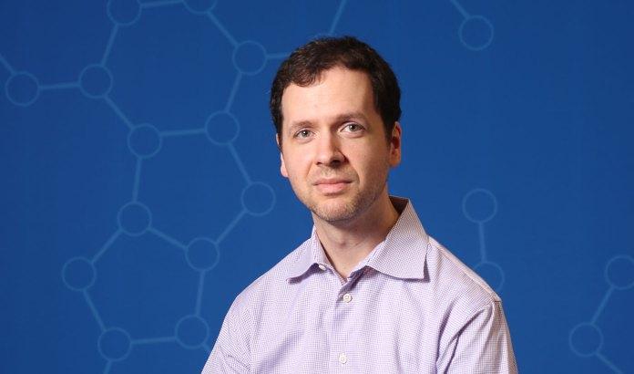Portrait photo of Jesse Gillis in his laboratory.