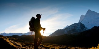 Silhouette of a hiker on the mountains, mini-retirement