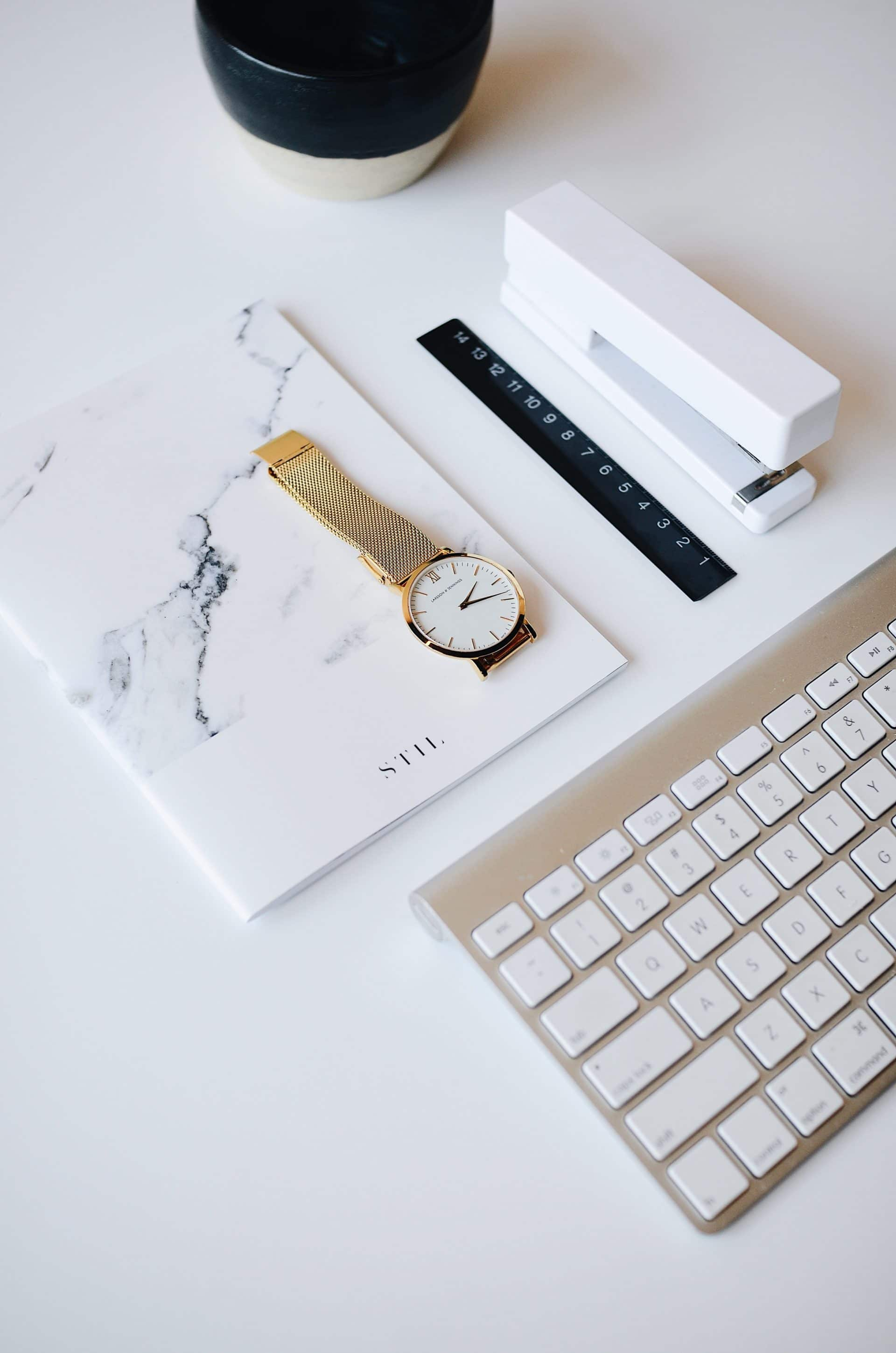 Picture of key board, watch and stationary for Real Estate News for Investors Podcast Episode #579