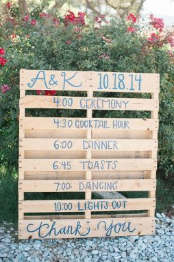 Wooden crates are an ingenious way to showcase your wedding's schedule. Photo: Brandi Welles