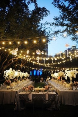 A gorgeous mixture of lanterns and lightbulbs at this romantic wedding. Photo: Habitat Events