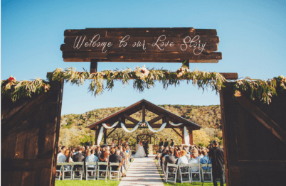 Welcome your guests to your gorgeous rustic reception with vintage old doors and handmade signs. Photo: Two Pair Photography