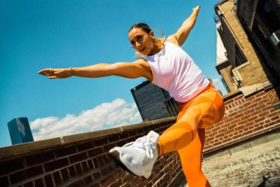 Woman doing workout on top of building