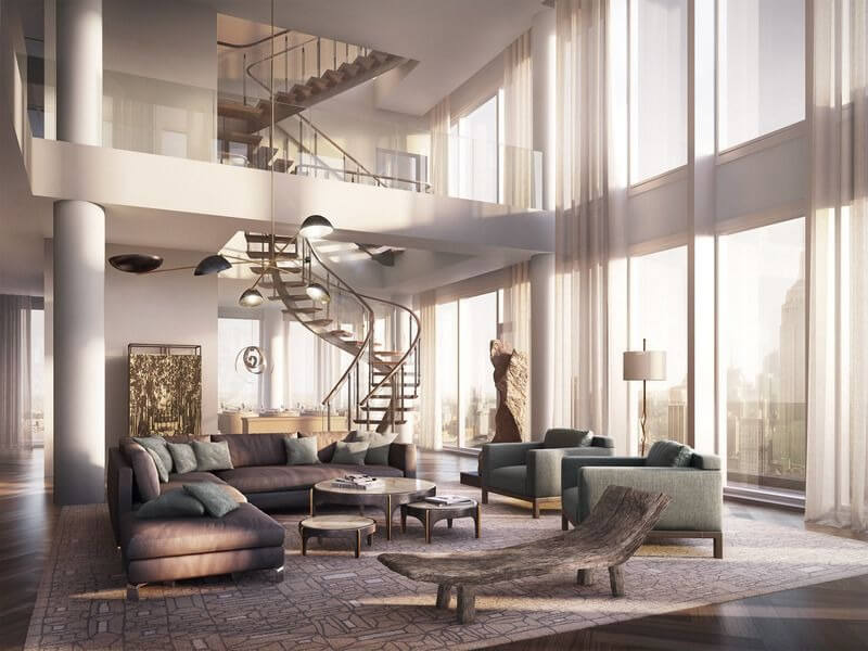 The living room is like an atrium where to one side spiral staircase rises two stories, each upper level being a loft space overlooking the living room