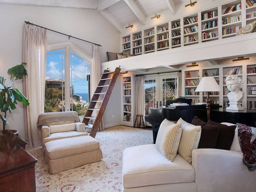 Bookshelves are a spectacular way to decorate a home.  This home takes bookshelves literally to the next level in the living room by creating a library loft within the living room