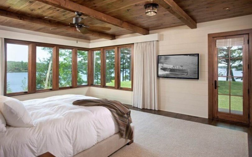 30 Glorious Bedrooms with a Ceiling Fan Horizontal running wooden panelling is painted a light cream to offset the  dark wood floors