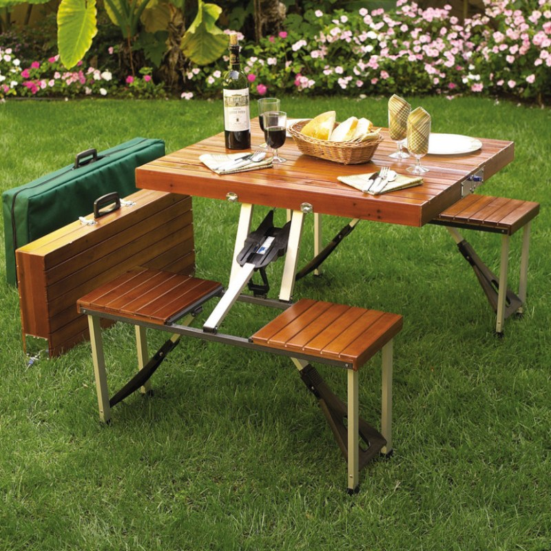 Here is a portable picnic table with a wooden look. This model folds up into an easy to carry case. It folds down small enough to tuck it away in the trunk of a car and easily travel to where there is need for a table.