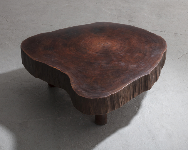 solid tree trunk coffee table made of a